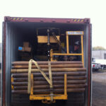 Loading the rig onto a container bound for Suriname.